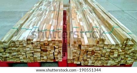Pile of wood in a warehouse. - stock photo