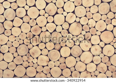 Pile of wood logs stumps for winter in vintage tone - stock photo