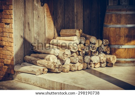 Pile of woods in fiont of the old house - stock photo
