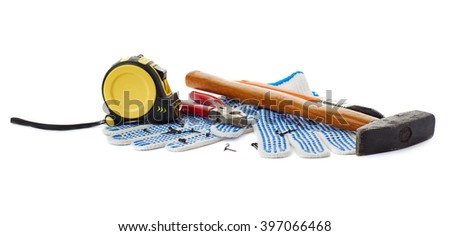 Pile of working tools as construction composition over isolated white background - stock photo