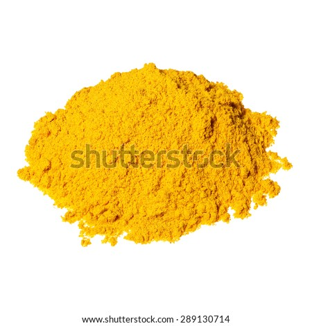 Pile of yellow curry powder isolated over the white background. - stock photo