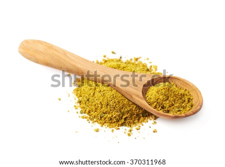 Pile of yellow curry seasoning isolated - stock photo