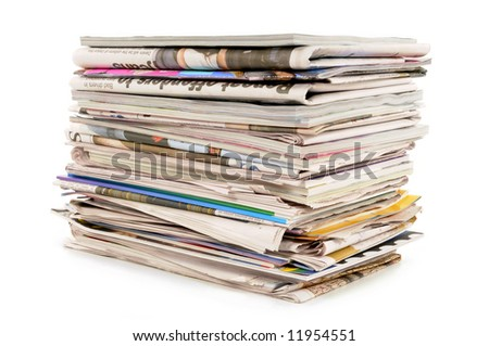 Pile or stack of old newspapers and magazines isolated on white background