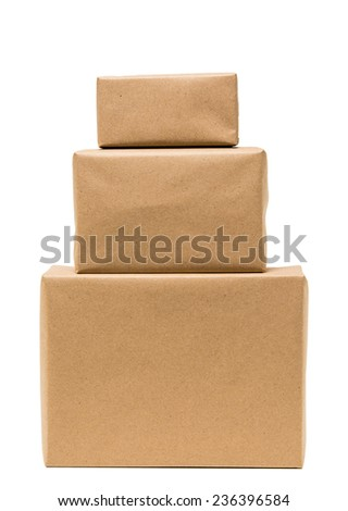 Pile parcel wrapped with brown kraft paper.front view