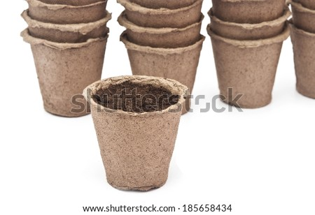 pile peat pots for growing seedlings, isolated on white background  - stock photo