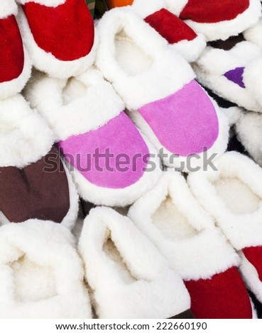 Pile slippers exposed to a fair - stock photo