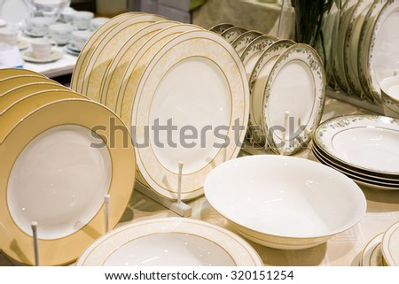 pile stack of clean washed dishes and plates - stock photo