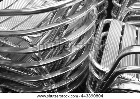 piled aluminum chairs - stock photo