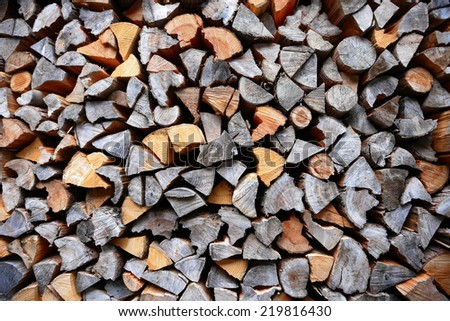 piled dry chopped firewood logs  - stock photo