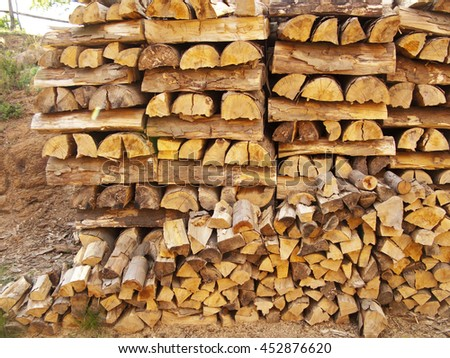 Piled firewood, wood texture close up - stock photo