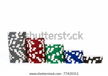 Piled poker chips in row isolated on white background