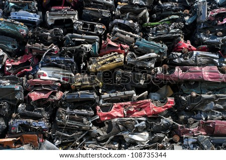 piled up compressed cars going to be shredded - stock photo