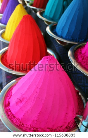 Piles & mounds of colorful dye powders for holi festival & other religious uses commonly found in indian markets. These dry flour heaps were taken at mysore bazaar, india & used mainly for rangoli