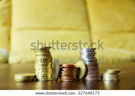 Piles of coins on a wooden table