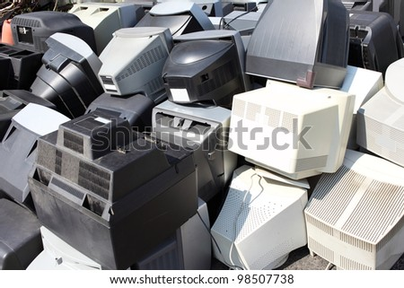 Piles of computer monitors for recycling - stock photo