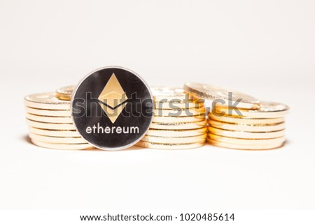 Piles of cryptocurrencies with a single Ethereum (ETH) Coin