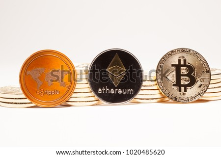Piles of cryptocurrencies with Ripple (XRP), Ethereum (ETH) and Bitcoin (BTC) Coins