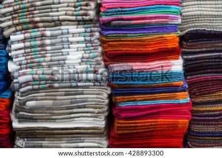 Piles of folded scarves in the Otavalo Market