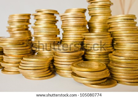 piles of golden coins, mexican ten pesos coins - stock photo