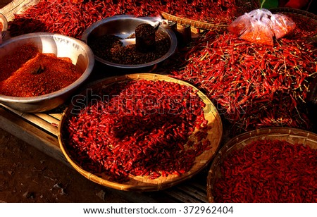 Piles of hot red peppers  at the central market, Kyaukme Myanmar (Burma) - stock photo