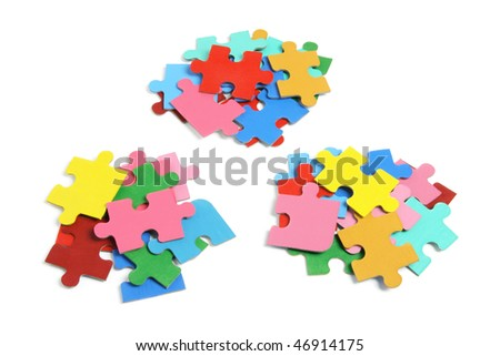 Piles of Jigsaw Puzzle Pieces on White Background
