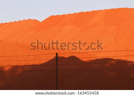 Piles of mining Bauxite in Weipa, Queensland, Australia  Bauxite is an aluminum ore and is the main source of aluminum.  - stock photo