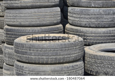 Piles of old tires in the sunlight - stock photo