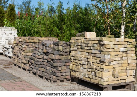 Piles of ornamental stones for sale in a garden centre - stock photo