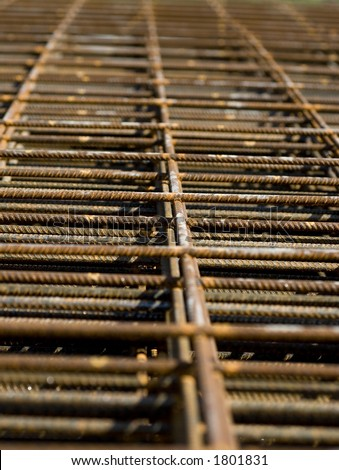 Piles of rebar mesh lay in a construction site