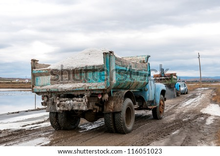 Piles of salt. Extraction and transportation of raw salt.