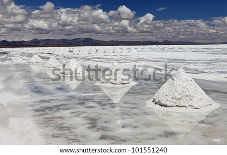 Piles of salt on the surface of the Salar de Uyuni salt lake, Bolivia - stock photo