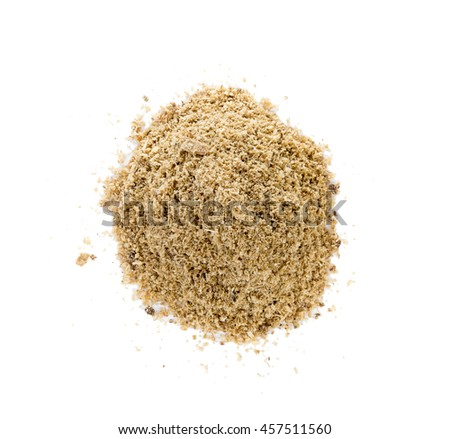 Piles of sawdust on a white background .