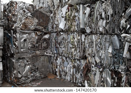 Piles of scrap metal bundled in cubes for recycling - stock photo
