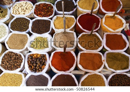 Piles of spices for sale. - stock photo