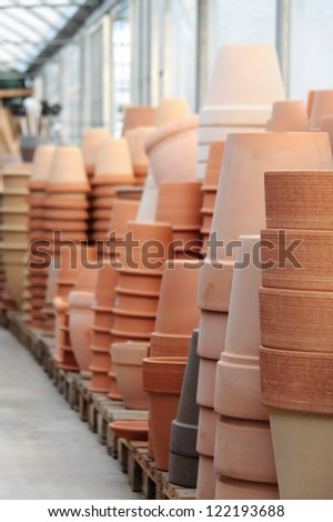 Piles of terracotta pots in a store - stock photo