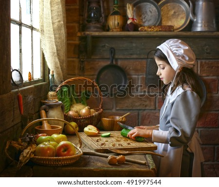 Pilgrim girl is cooking in the kitchen