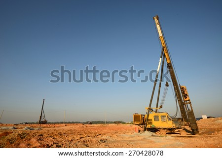 Piling works vehicle on an empty land - stock photo