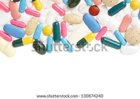 Pill and colorful medical capsule frame, border on white, clipping path included - stock photo