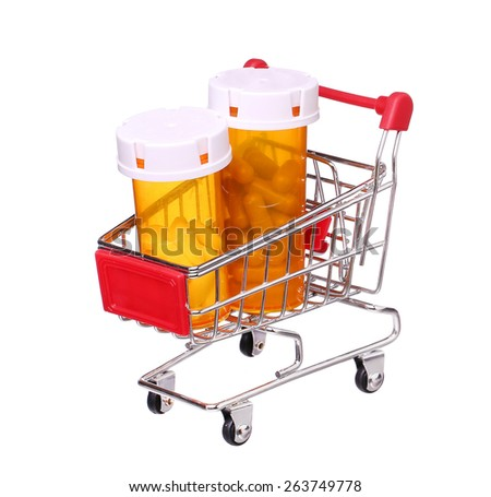Pill bottle in shopping cart isolated on white background
