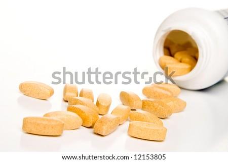 Pill bottle on white - stock photo
