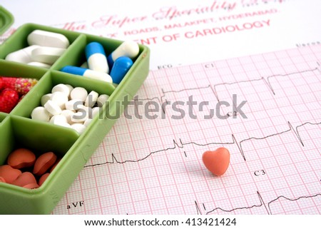 Pill box on electrocardiogram print