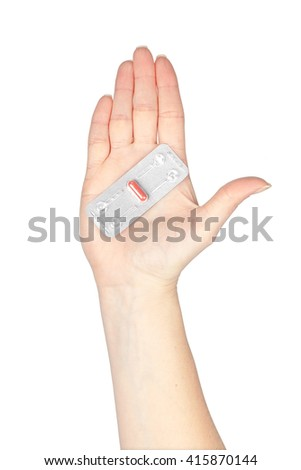 pill in a hand isolated on white background. medicine