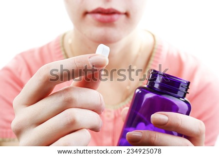 Pill in hand, close-up - stock photo