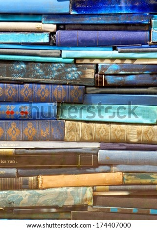 pill of blue books stacked together - stock photo