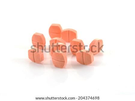 pill of vitamin C on white background - stock photo