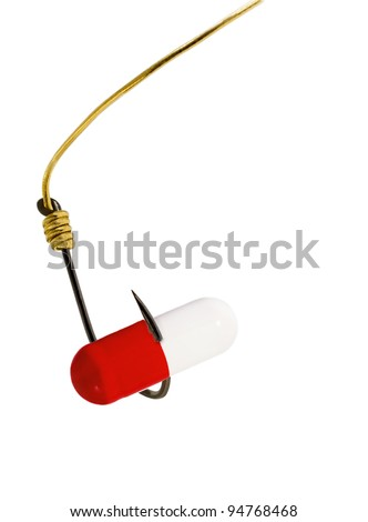 pill on fishing hook isolated on white background