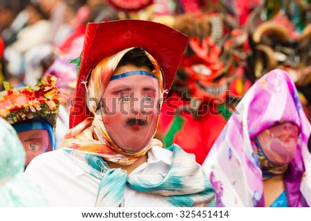 Pillaro, Ecuador - 12 August 2012: Children Disguised As Adults Marching On The Streets During The Diablada Festivities In Pillaro On August 12, 2012 - stock photo