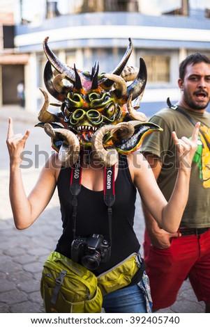 Pillaro, ECUADOR - FEBRUARY 6, 2016: Unidentified woman, dressed as Devil in the diabladas festivities in Pillaro - stock photo