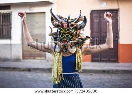 Pillaro, ECUADOR - FEBRUARY 6, 2016: Unidentified woman, dressed as Devil in the diabladas festivities in Pillaro. - stock photo