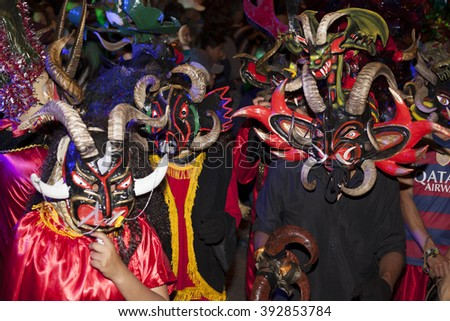 Pillaro, ECUADOR - FEBRUARY 6, 2016: Unknown locals dressed up participating in the Diablada, popular town celebrations with people dressed as devils dancing in the streets